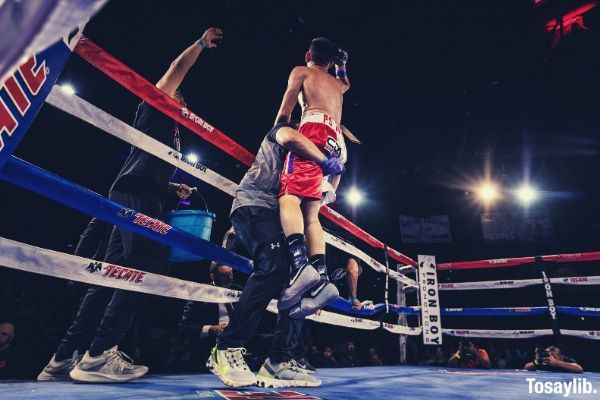 man in red jersey short boxing