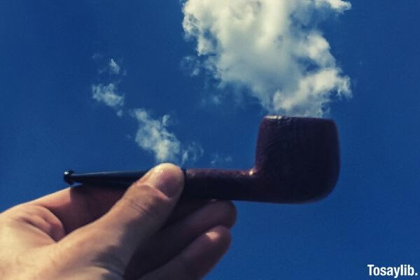 close up photo of pipe and clouds sky