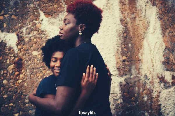 two black girls hugging