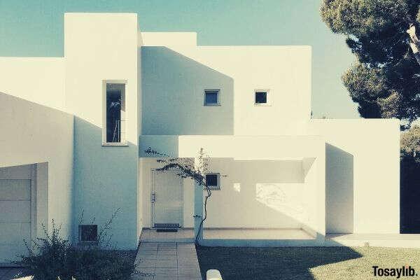 white 2 storey house near trees