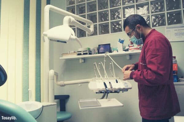 dentist arranging medical equpments