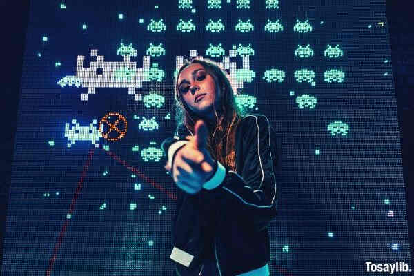 woman wearing black jacket pixel game background