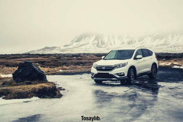 white Honda SUV land mountain