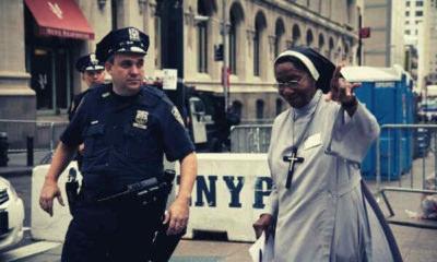 policeman-assisting-a-nun