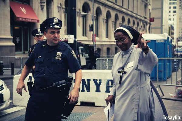 policeman assisting a nun