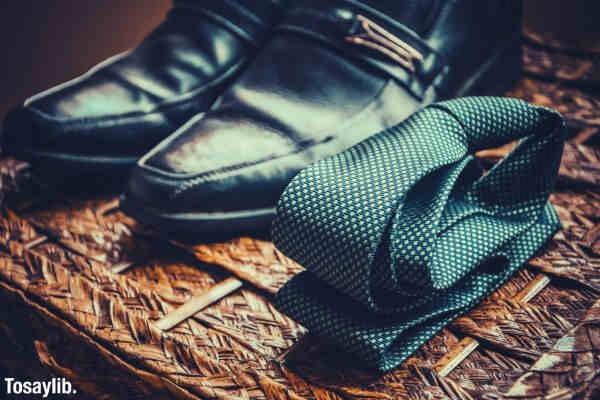 vintage shot black shoes and folded necktie