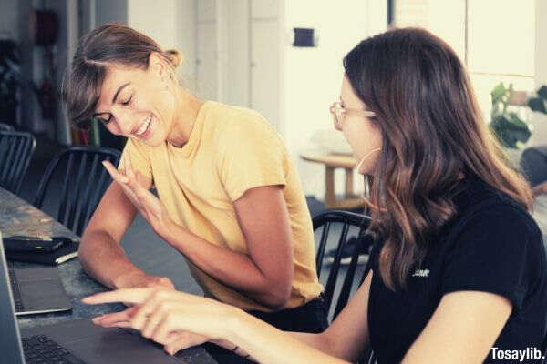photo of women having conversation laptop