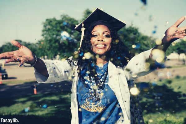woman graduate throwing confetti