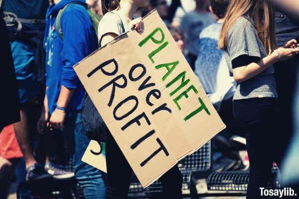 planet over profit signage