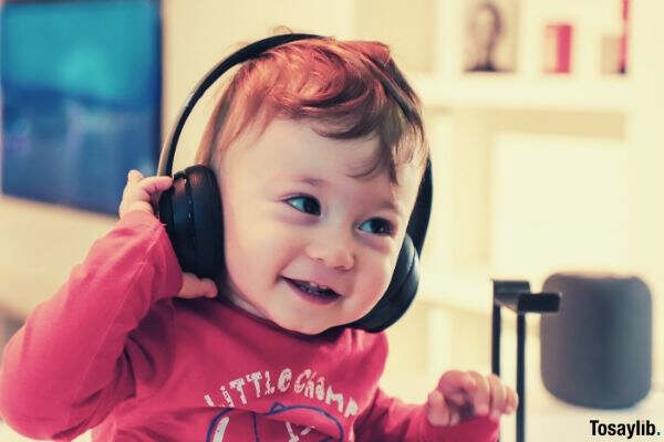 baby listening to black headset