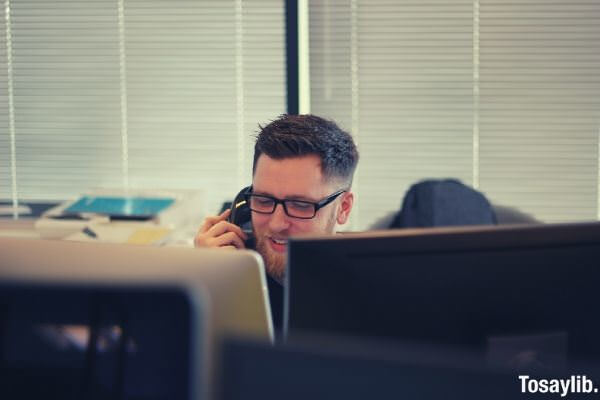 man using phone in the office