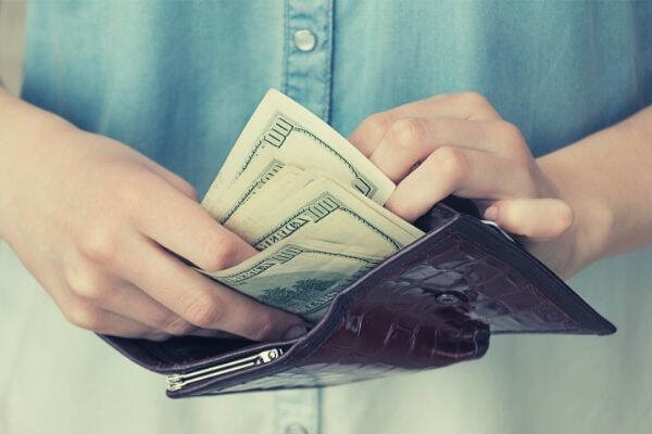 a-girl-with-a-wallet-in-her-hands-business-savings-investment-paper-banking-financial-bank-hand-human