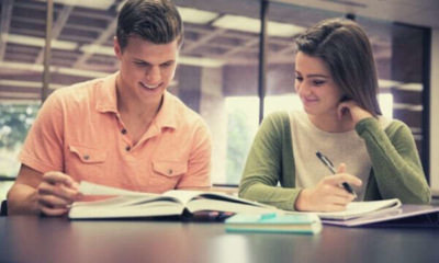 foreign-college-couple-studying-on-their-own