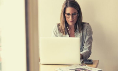 woman-with-gray-glasses-working-on-laptop