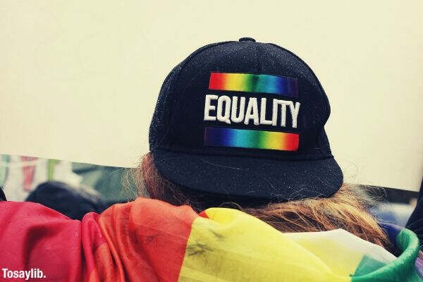 person wearing black equality hat