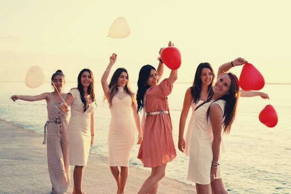 group-of-women-holding-balloons-sea