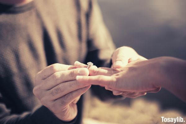 person holding silver diamond ring photo