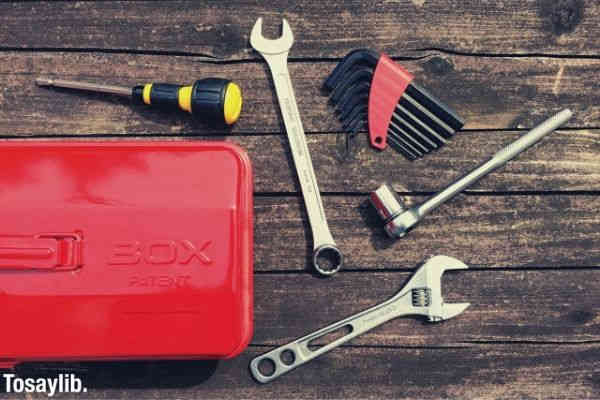 red tool box and various tools