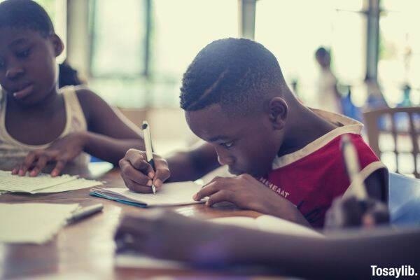 boy black writing