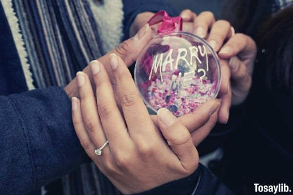 person holding marry me ball