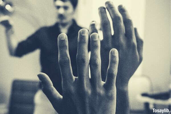 05 two people raising their hand greyscale