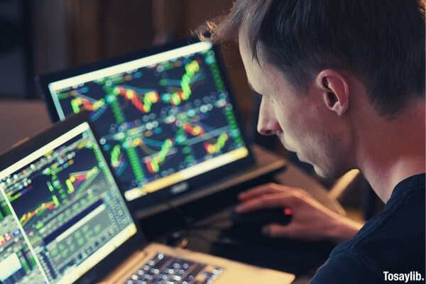 03 man looking at his laptop technical analysis stock market