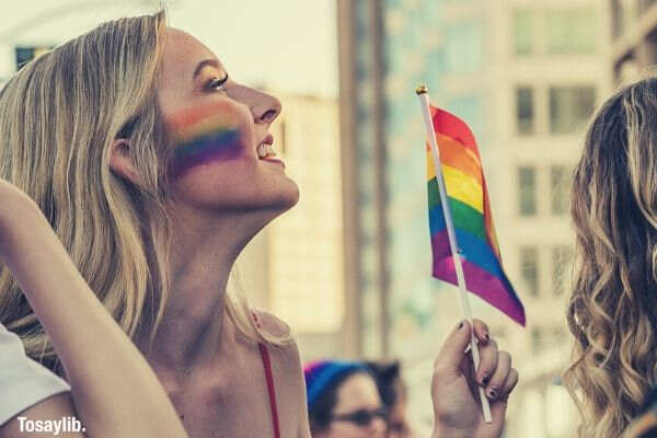 photo-of-a-woman-holding-LGBT-flag