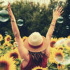 feature-photography-of-woman-surrounded-by-sunflowers