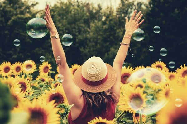 photography-of-woman-surrounded-by-sunflowers