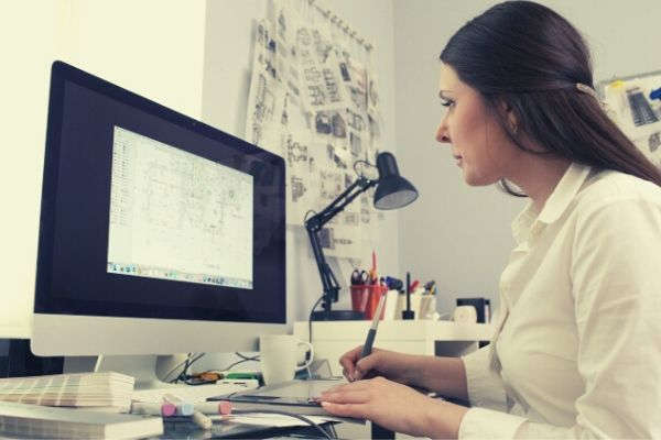 woman-working-on-a-document-in-computer