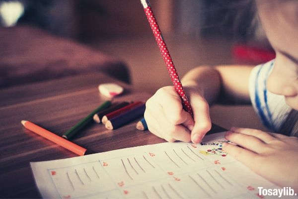 close up picture of girl writing