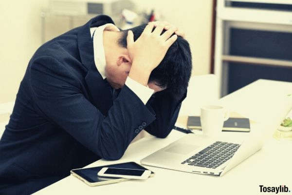 man businessman holding his head