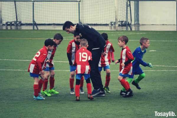 children playing soccer photo
