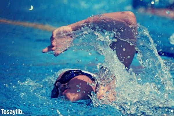 swimming pool person swimming goggles