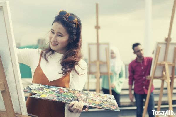 woman painting smiling