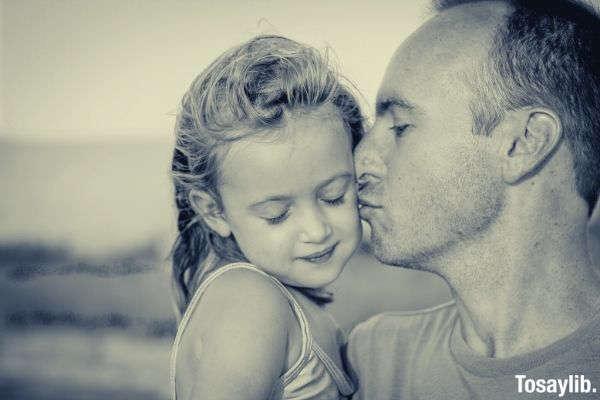 man kissing his daughter