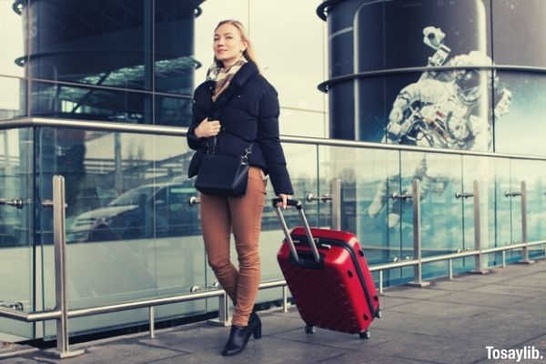 09 woman walking with luggage bag