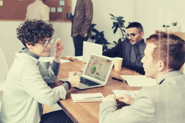people-sitting-indoors-having-a-meeting