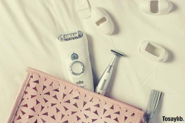white shaver on white textile photo