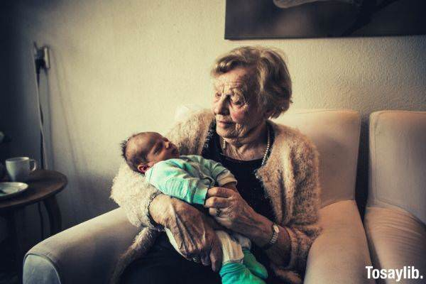 grandmother holding a baby
