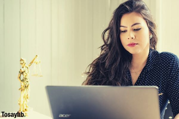 woman in black polka dots using acer laptop
