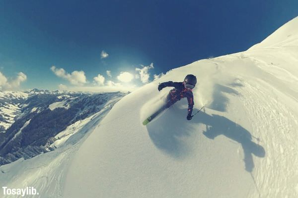 photography of a person skiing snow sky sun