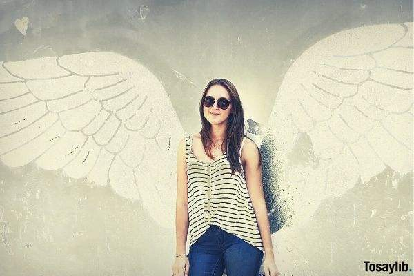 girl photo with wings on the wall