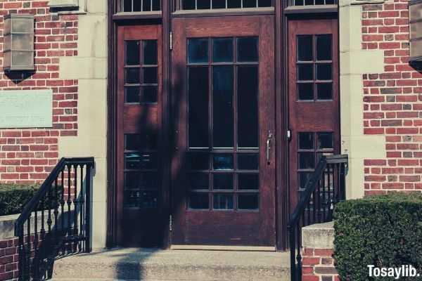brown wooden door stairs