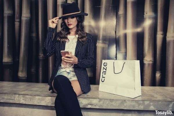 photo of a woman sitting near paperbag