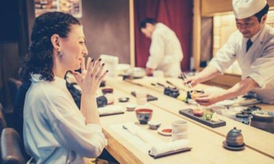 woman-sitting-looking-at-the-sushi