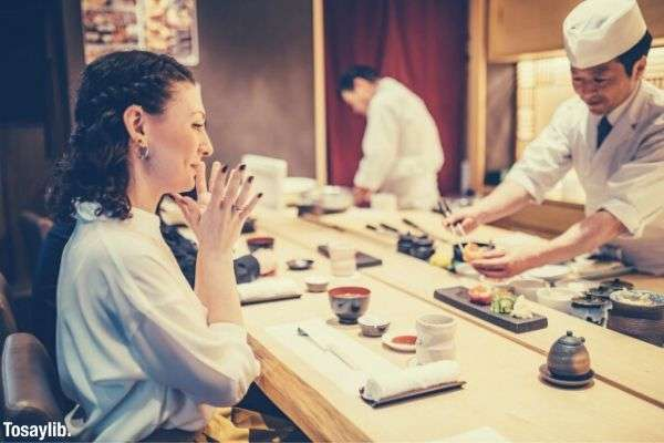 woman sitting looking at the sushi
