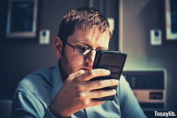businessman cell phone concentration eyeglasses