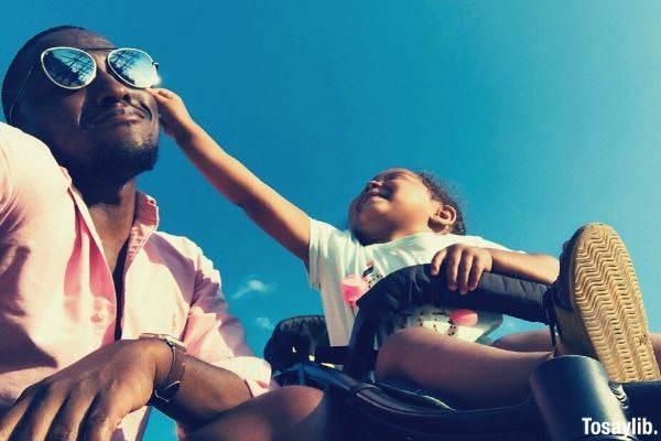 baby girl touching man s black sunglasses