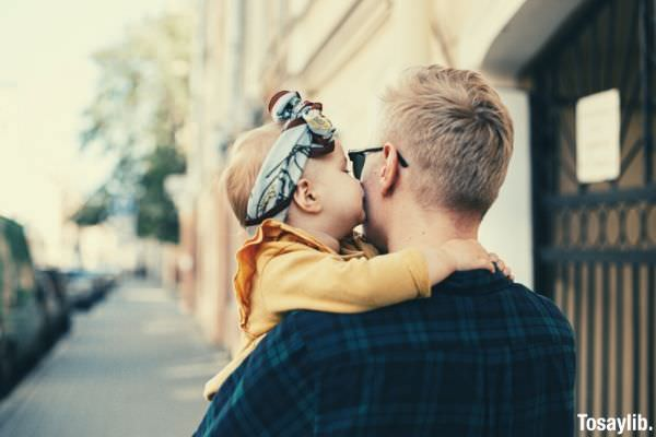 daughter kissing her daddy